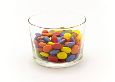 multicolored chocolate candies in glass bowl photo