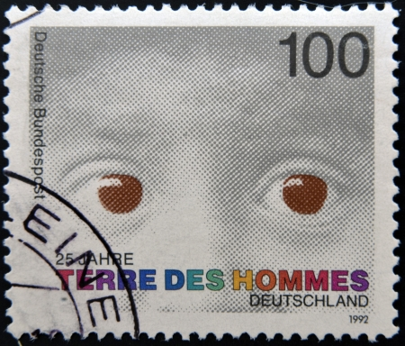 equitable: GERMANY - CIRCA 1992: A stamp printed in Germany dedicated to international federation terre des hommes shows the eyes of a child, circa 1992