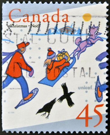 CANADA - CIRCA 1990: A stamp printed in Canada shows image of children playing in the snow, circa 1990  photo