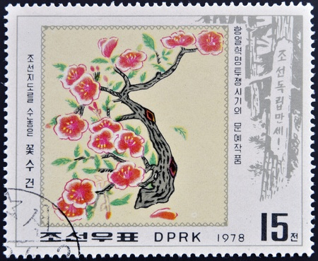 NORTH KOREA - CIRCA 1978: A stamp printed in North Korea shows image of Plum Blossom, circa 1978  photo