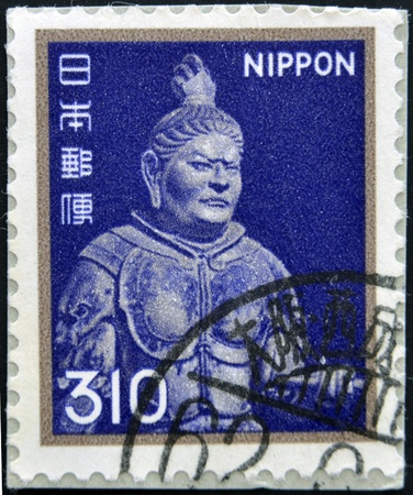 dera: JAPAN - CIRCA 1962: A stamp printed in Japan shows a metal sculpture of Kōmokuten. One of the four heavenly guardians, the king of the West, circa 1962