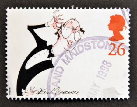 UNITED KINGDOM - CIRCA 1998: A stamp printed in Great Britain shows Eric Morecombe, comedian, circa 1998 Stock Photo - 15460768