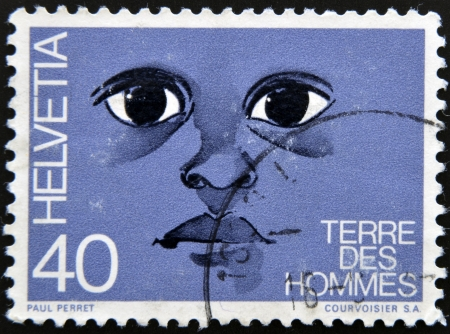 equitable: SWITZERLAND - CIRCA 1992: A stamp printed in Switzerland dedicated to international federation terre des hommes shows the eyes of a child, circa 1992 Editorial