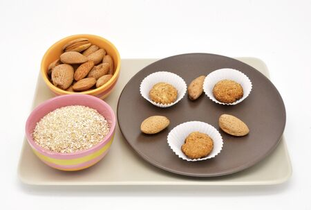 composition with almond cookies and oatmeal photo