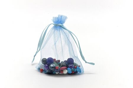 organza: Blue cloth bag filled with glass beads for jewelry Stock Photo