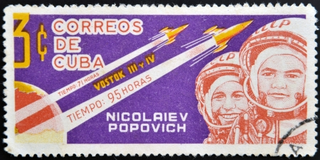 vostok: CUBA - CIRCA 1963: A stamp printed in Cuba shows Nikolayev and Popovich with rocket Vostok 3 and 4, circa 1963