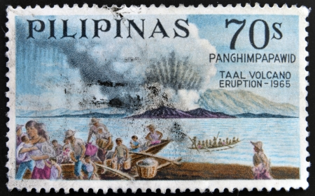 PHILIPPINES - CIRCA 1967: A stamp printed in Philippines shows Taal volcano eruption - 1965, circa 1967