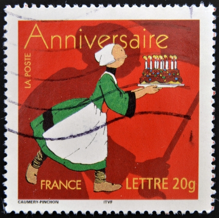 FRANCE - CIRCA 2006: stamp printed in France shows woman with cake, circa 2006  Stock Photo - 15670241