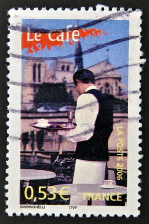FRANCE - CIRCA 2006: A stamp printed in France dedicated to coffee shows a waiter serving a coffee on a terrace in Paris, circa 2006