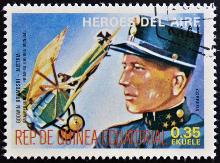 equatorial: EQUATORIAL GUINEA - CIRCA 1974: stamp printed in Guinea dedicated to air heroes, shows Godwin Brumoski, historic aviator of the First World War, circa 1974