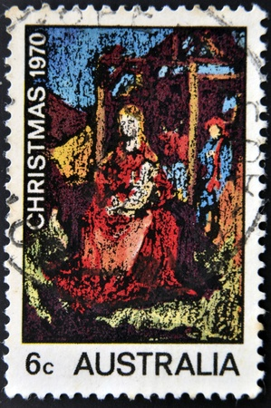 mother mary: AUSTRALIA - CIRCA 1970  a stamp printed in Australia shows an abstract art of the virgin Mother Mary holding baby Jesus, circa 1970   Editorial