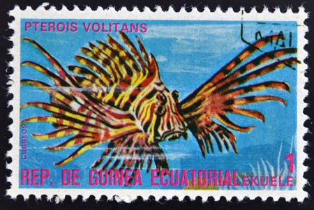 pterois volitans: EQUATORIAL GUINEA - CIRCA 1974: A stamp printed in Guinea Ecuatorial dedicated to exotic fish shows pterois volitans, circa 1974.  Editorial