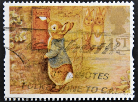 UNITED KINGDOM - CIRCA 1994: A stamp printed in Great Britain shows Peter Rabbit posting Letter, circa 1994