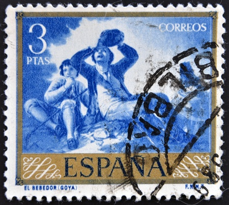 SPAIN - CIRCA 1958: A stamp printed in Spain shows paintings The Drinker by Francisco de Goya, circa 1958 Stock Photo - 15745114