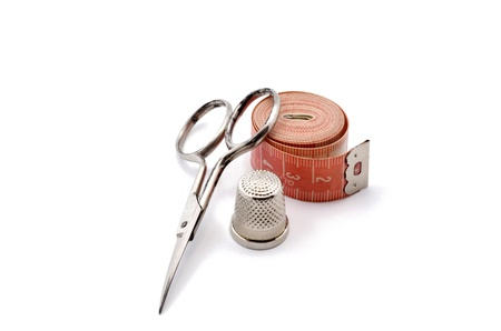 Kit consists of cutting and sewing scissors, thimble and tape measure photo