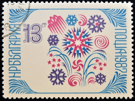 BULGARIA - CIRCA 1987: a stamp printed in Bulgaria shows snowflake, a symbol of the new years holiday, circa 1987  photo