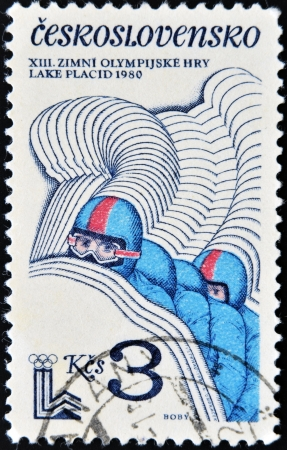 CZECHOSLOVAKIA - CIRCA 1980: A stamp printed in Czechoslovakia dedicated to Winter Lake Placid shows Bobsleigh, circa 1980  Stock Photo - 16020415