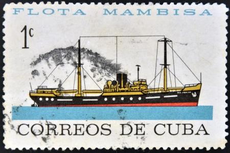 CUBA - CIRCA 1962: A stamp printed in Cuba dedicated to Mambisa fleet, shows jibacoa river ship, circa 1962 Stock Photo - 16020442