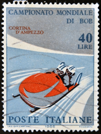 to steer a sledge: ITALY - CIRCA 1966: stamp printed in Italy shows Two-man bobsled, circa 1966