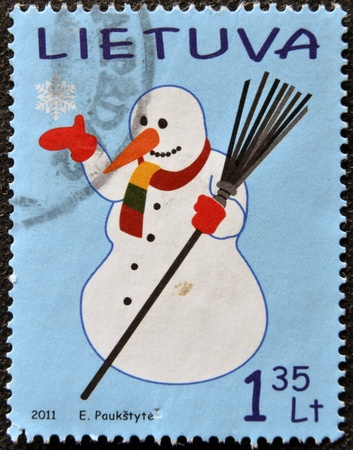 LITHUANIA - CIRCA 2011: A stamp printed in Lithuania shows Snowman, circa 2011 photo