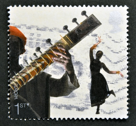 UNITED KINGDOM - CIRCA 2006  A stamp printed in Great Britain dedicated to sounds of Britain shows Bollywood and Bhangra, circa 2006