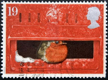UNITED KINGDOM - CIRCA 1996  a stamp printed in Great Britain shows image of a robin sitting in a postbox, circa 1996  photo