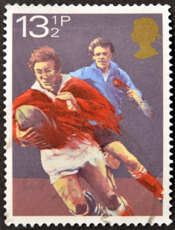rugger: UNITED KINGDOM - CIRCA 1980  A stamp printed in Great Britain dedicated to rugby, circa 1980