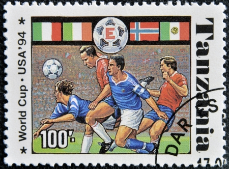 TANZANIA - CIRCA 1994: A stamp printed in Tanzania dedicated to USA, 1994 shows footbal players, circa 1994 Stock Photo - 16020411