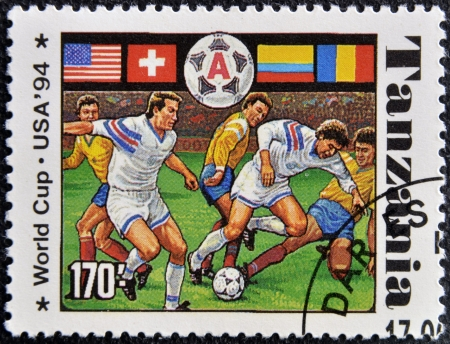 TANZANIA - CIRCA 1994: A stamp printed in Tanzania dedicated to USA, 1994 shows footbal players, circa 1994 Stock Photo - 16020429