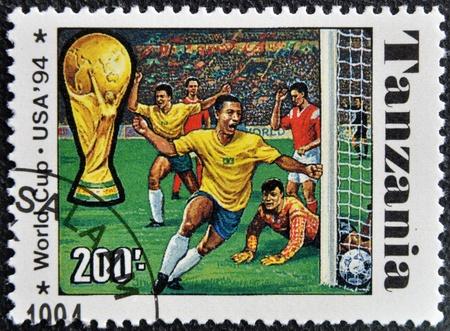 TANZANIA - CIRCA 1994: A stamp printed in Tanzania dedicated to USA, 1994 shows footbal players, circa 1994 Stock Photo - 16020409