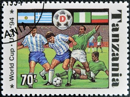 TANZANIA - CIRCA 1994: A stamp printed in Tanzania dedicated to USA, 1994 shows footbal players, circa 1994 Stock Photo - 16020448