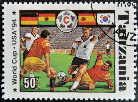 TANZANIA - CIRCA 1994: A stamp printed in Tanzania dedicated to USA, 1994 shows footbal players, circa 1994 Stock Photo - 16020430