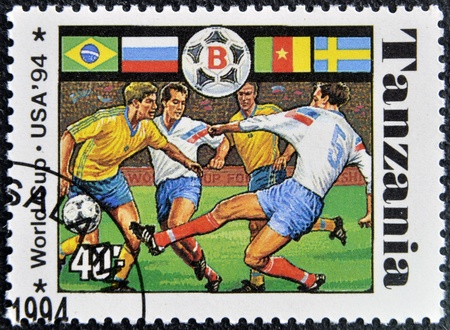 TANZANIA - CIRCA 1994: A stamp printed in Tanzania dedicated to USA, 1994 shows footbal players, circa 1994 Stock Photo - 16020431