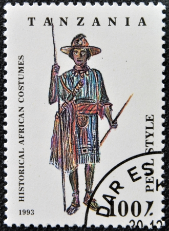 TANZANIA - CIRCA 1993: A stamp printed in Tanzania dedicated to historical african costumes, shows peul style, circa 1993 photo