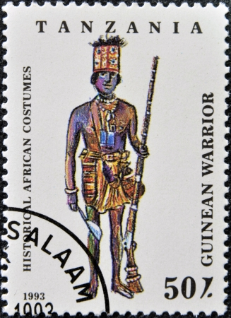 TANZANIA - CIRCA 1993: A stamp printed in Tanzania dedicated to historical african costumes, shows guinean warrior, circa 1993