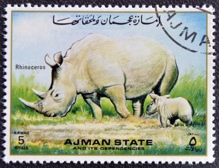 MANAMA AJMAN - CIRCA 1967: a stamp printed in Ajman shows Rhinoceros, circa 1967  Stock Photo