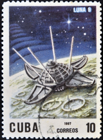 CUBA - CIRCA 1967: A stamp printed in Cuba shows Luna 9 spacecraft, circa 1967. photo