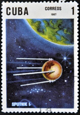 CUBA - CIRCA 1967: A stamp printed in Cuba shows flight of first soviet spaceship Sputnik, circa 1967  photo