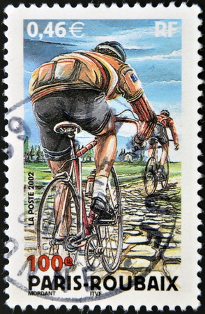 FRANCE - CIRCA 2002: stamp printed in France shows Paris-Roubaix Bicycle Race, circa 2002 Stock Photo - 16136601