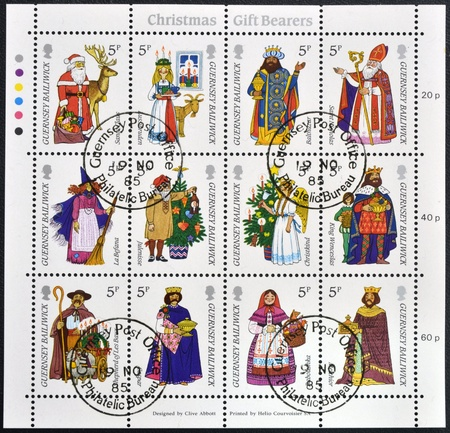 GUERNSEY - CIRCA 1985: Collection stamps printed in Guernsey shows gift bearers, circa 1985