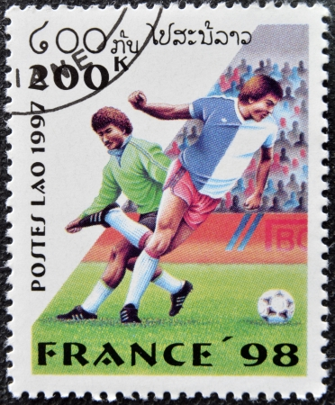LAOS - CIRCA 1997  A stamp printed in Laos dedicated to Soccer World Championship of France 1998, circa 1997 Stock Photo - 16127734