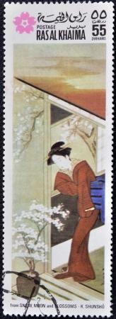RAS AL KHAIMA - CIRCA 1970: A stamp printed in Ras-Al-Khaima (United Arab Emirates) shows detail from snow, moon and  Blossoms by K. Shunsho, circa 1970.  photo