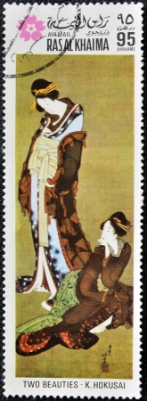 chinese postage stamp: RAS AL KHAIMA - CIRCA 1970: A stamp printed in Ras-Al-Khaima (United Arab Emirates) shows two beauties by K. Hokusai, circa 1970.