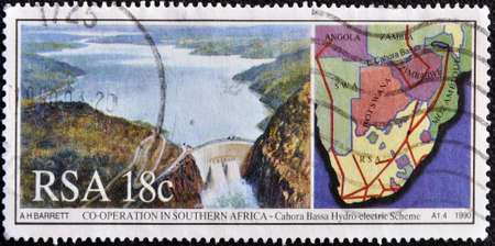 rsa: SOUTH AFRICA - CIRCA 1990: A stamp printed in RSA dedicated to hydroelectric cooperation in Southern Africa shows landscapes and maps, circa 1990.