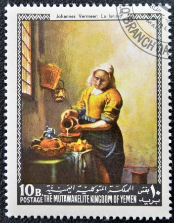 yemen: YEMEN - CIRCA 1968: A stamp printed in Yemen shows The Milkmaid by Johannes Vermeer, circa 1968