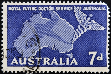 AUSTRALIA - CIRCA 1958: A stamp printed in Australia shows Royal Flying Doctor Service of Australia, Caduceus and Map of Australia, circa 1958  photo