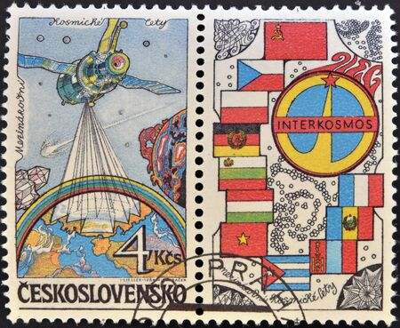 CZECHOSLOVAKIA - CIRCA 1984: A stamp printed in Czechoslovakia dedicated to Soviet Intercosmos program shows orbital station and flag, circa 1984  photo