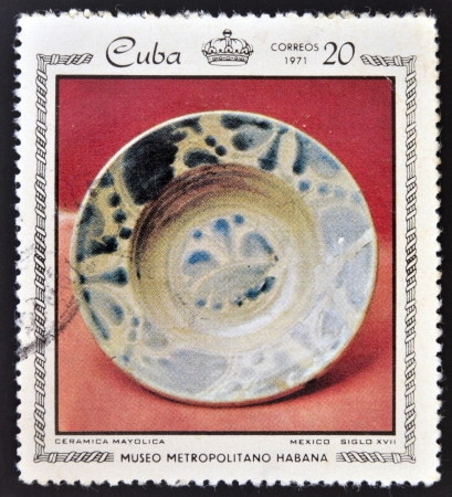 CUBA - CIRCA 1971: Stamp printed in Cuba dedicated to works from the Metropolitan Museum of Havana, shows majolica ceramics, Mexico, XVII Century, circa 1971 Stock Photo - 16306948
