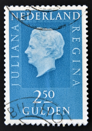 HOLLAND - CIRCA 1969: A stamp printed in the Netherlands showing a portrait of Queen Juliana, circa 1969.