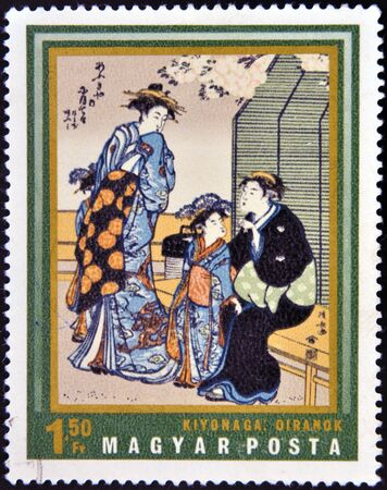 HUNGARY - CIRCA 1971: A stamp printed in Hungary shows Courtesans by Kiyonaga, circa 1965  photo